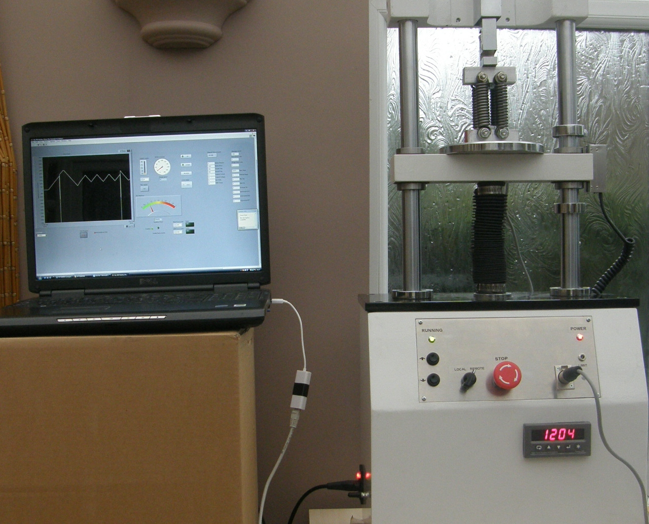 Automated force testing stand, computer controlled data acquisition and report generation.